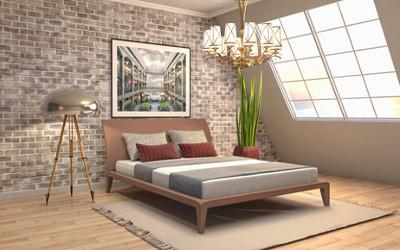 Schlafzimmer mit moderner Beleuchtung und Dachschräge